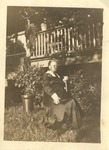 Mary Robinson Hause Seated Outside Home by unknown