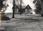 Exterior of Unknown Home 219 by Rayford B. Taylor
