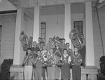 Group of 1950s Musicians Outside College Music Building with Instruments 1 by Opal R. Lovett