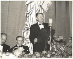 Man Speaks from Podium at International House Dedication Banquet by Lance Johnson