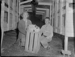 Mrs. Hannah M. Hilley with Nephew Jimmie Sutley Caring for Rabbits by Opal R. Lovett