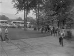 Group of Men Walk Campus After Deboarding Buses by Opal R. Lovett
